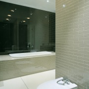 view of this bathroom showing gsi toilet and architecture, bathroom, ceiling, floor, flooring, glass, interior design, property, room, tile, wall, gray, green
