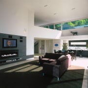 A view of the living area, concrete tiled ceiling, floor, flooring, interior design, living room, room, gray, black