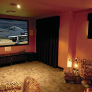 A view of a home theatre, patchy brown ceiling, entertainment, home, interior design, lighting, room, wall, red