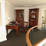 A view of the study area, brown carpet, floor, flooring, home, interior design, property, real estate, room, orange