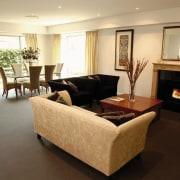 A view of a living area, brown carpet, ceiling, floor, flooring, hardwood, home, interior design, living room, property, real estate, room, wood flooring, orange