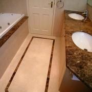 view of the vanity with double basins, stainless bathroom, countertop, floor, flooring, hardwood, property, room, sink, tile, toilet seat, wood, brown, orange
