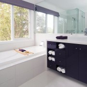 view of the bathroom incluber shower and bath, bathroom, bathroom accessory, bathroom cabinet, interior design, room, sink, window, gray