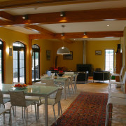 A view of a dining area, cream tiled ceiling, dining room, flooring, function hall, interior design, lobby, real estate, room, brown