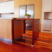 A view of a kitchen area, wooden flooring cabinetry, countertop, floor, flooring, furniture, hardwood, interior design, kitchen, laminate flooring, plywood, room, table, wood, wood flooring, wood stain, red