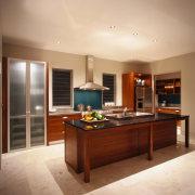 A view of a kitchen, wooden cabinetry, granite cabinetry, countertop, cuisine classique, floor, flooring, hardwood, interior design, kitchen, real estate, room, orange, brown