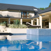 view of the pool that appears to wrap estate, home, hotel, house, leisure, mansion, property, real estate, resort, swimming pool, villa, window