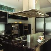 A view of a kitchen area, black granite ceiling, countertop, interior design, kitchen, under cabinet lighting, black