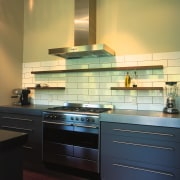 Example of freestanding cooker and chimney from Smeg cabinetry, countertop, interior design, kitchen, kitchen stove, room, under cabinet lighting, orange, black
