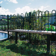 Bench seat in front of steel fence. - fence, grass, outdoor structure, plant, real estate, tree, water, white, black