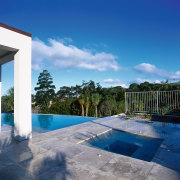 View of spa pool set into paving stones cloud, estate, home, house, leisure, property, real estate, reflection, resort, sky, swimming pool, vacation, villa, water, blue