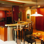 A view of the kitchen and dining areas, dining room, interior design, kitchen, restaurant, room, table, brown, red