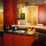 A view of a kitchen, wooden cabinetry and cabinetry, ceiling, countertop, interior design, kitchen, room, under cabinet lighting, wall, red