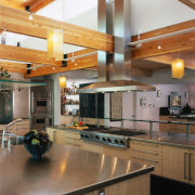 view of the kitchen featuring light wood veneer cabinetry, ceiling, countertop, daylighting, interior design, kitchen, real estate, room, wood, brown