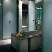 A view of a bathroom. - A view bathroom, bathroom accessory, glass, interior design, gray, black