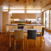 view of the kitchen that opens onto one architecture, ceiling, dining room, floor, flooring, furniture, hardwood, house, interior design, real estate, table, wood, wood flooring, brown