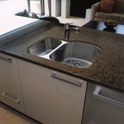 A view of a kitchen, brown benchtop and bathroom sink, countertop, kitchen, plumbing fixture, sink, tap, black, gray