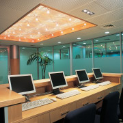 Computer room at Crown Institute of Studies - ceiling, conference hall, interior design, office, orange