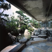 A view of the exterior area, many plants architecture, house, landscape, outdoor structure, plant, tree, water, black, gray