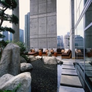 AN exterior view of the patio area, concrete architecture, building, condominium, roof, gray, black