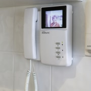 the infrared intercom system has a camera located electronic device, electronics, intercom, product, product design, security alarm, technology, gray