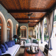 the loggia is decorated with handmade stoneware tiles, ceiling, estate, home, interior design, living room, real estate, black