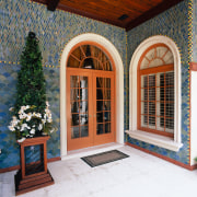 view of the tiles that are laid in door, facade, home, window, gray