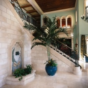 the best cuts of stone were positioned round arecales, courtyard, estate, home, interior design, lobby, palm tree, property, real estate, gray