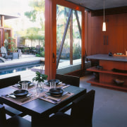 A view of a kitchen by David Hertz interior design, living room, real estate, table, window, red