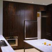 view of the kitchen that has bamboo flooring, cabinetry, floor, flooring, furniture, interior design, room, wall, wood, black, gray