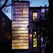 Architect David Jameson modern insertion into this row architecture, building, facade, glass, home, house, landscape lighting, light, lighting, purple, reflection, window, black