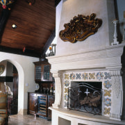 view of the fireplace that is embedded in fireplace, hearth, interior design, gray, black