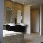 view of this bathroom featuring tiled flooring, timber architecture, bathroom, ceiling, floor, flooring, interior design, lobby, room, sink, tile, wall, gray, brown