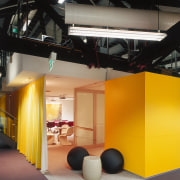 A view of a communal area. - A architecture, ceiling, interior design, product design, black, orange