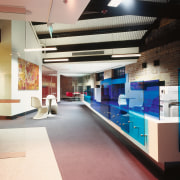 A view of the office area, carpet, glass architecture, interior design, lobby, black
