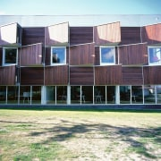 An exterior view of the library. - An architecture, building, facade, house, real estate, residential area, siding, window, wood, white