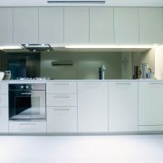 A view of a kitchen with some Omega cabinetry, countertop, furniture, home appliance, kitchen, product, product design, gray