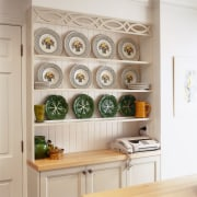 An example of one of Debra DeLorenzo's style cabinetry, furniture, interior design, kitchen, kitchen organizer, shelf, shelving, wall, gray