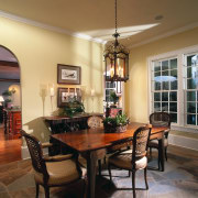 A view of the dining room. - A ceiling, dining room, furniture, hardwood, home, interior design, living room, room, table, window, brown