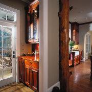 A view of the kitchen area. - A cabinetry, countertop, door, flooring, hardwood, home, interior design, kitchen, room, window, wood, brown, gray
