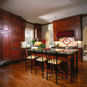 A view of the kitchen, wooden flooring and cabinetry, ceiling, countertop, cuisine classique, dining room, floor, flooring, hardwood, interior design, kitchen, laminate flooring, room, table, wood, wood flooring, brown, red