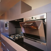 An example of the different appliances offered by cabinetry, countertop, gas stove, home appliance, interior design, kitchen, kitchen appliance, kitchen stove, major appliance, microwave oven, oven, gray, black