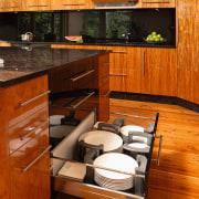 Kitchen with timber veneer cabinetry, black granite benchtops, cabinetry, countertop, cuisine classique, floor, flooring, furniture, hardwood, interior design, kitchen, room, wood, wood flooring, wood stain, brown
