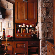 view of the oak cabinetry and black granite cabinetry, countertop, cuisine classique, furniture, interior design, kitchen, kitchen organizer, room, wood stain, red