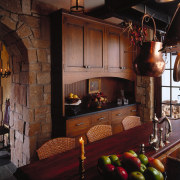 view of the dining area featuring oak table, fireplace, furniture, hearth, home, interior design, lighting, living room, room, black