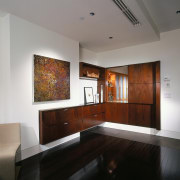 A view of the wooden shelving used throughout ceiling, floor, furniture, interior design, living room, room, gray, black
