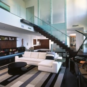 A view of the living area, wooden flooring, architecture, ceiling, interior design, living room, lobby, gray, black