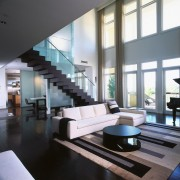 A view of the living area, wooden flooring, architecture, ceiling, daylighting, interior design, living room, lobby, loft, window, black, white, gray