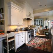 A view of the kitchen area, wooden flooring cabinetry, countertop, cuisine classique, floor, flooring, interior design, kitchen, room, gray