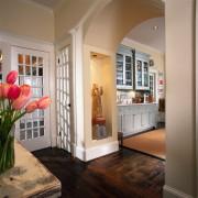 A view of the hallway. - A view cabinetry, ceiling, door, floor, flooring, hardwood, home, interior design, living room, real estate, room, window, wood flooring, brown, gray